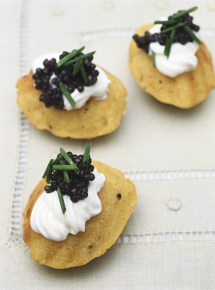 Sweet corn madeleines with sour cream and caviar