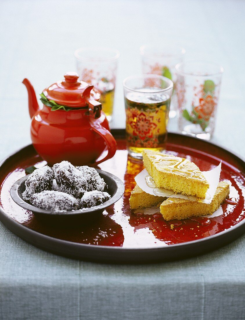 Coconut dates and semolina slices with mint tea