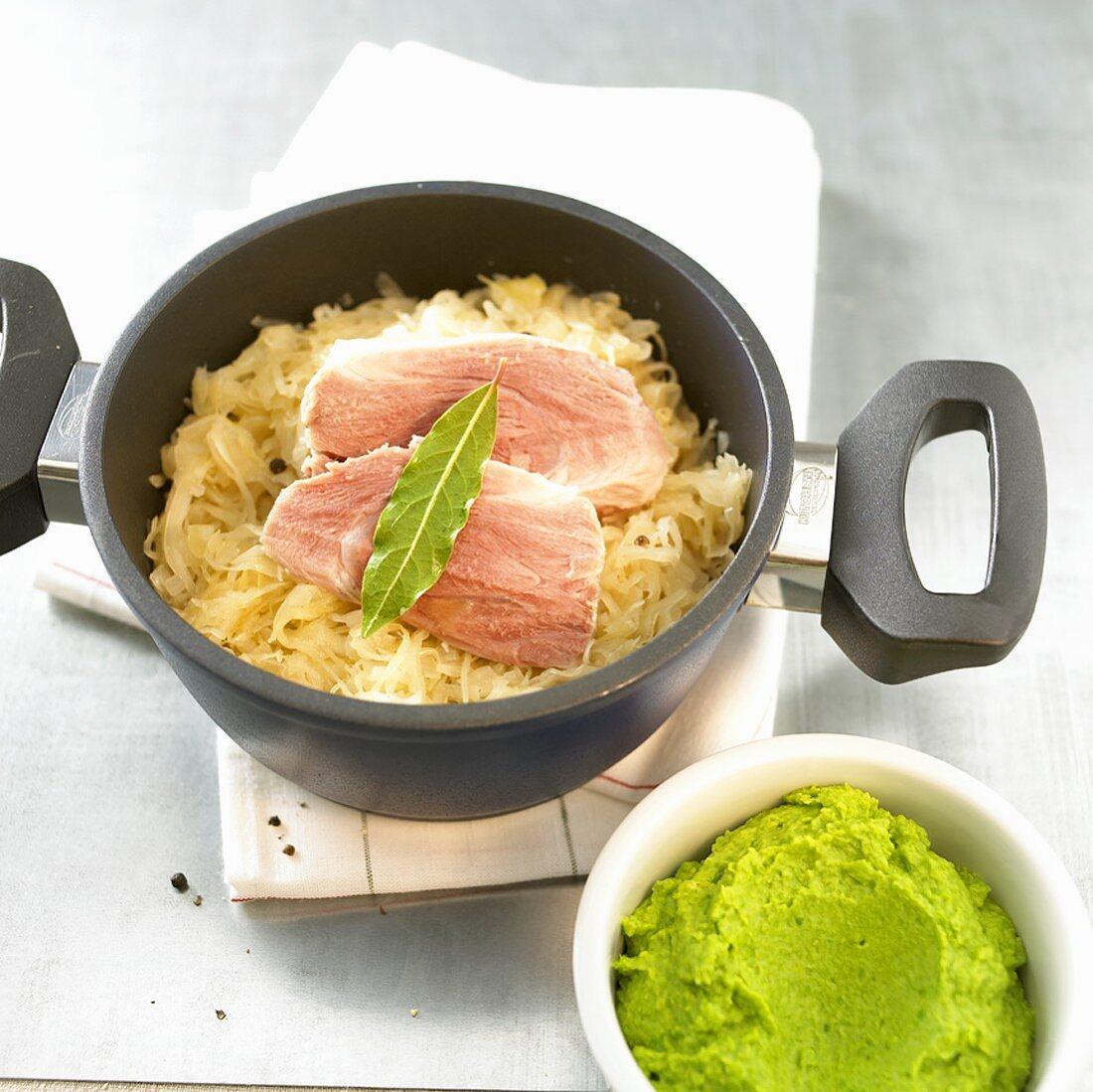 Eisbein (knuckle of pork) on sauerkraut with pea puree