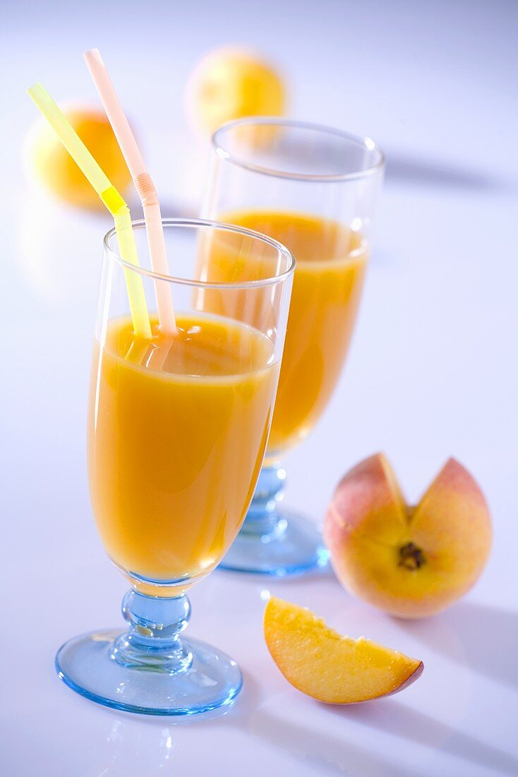 Two glasses of peach nectar