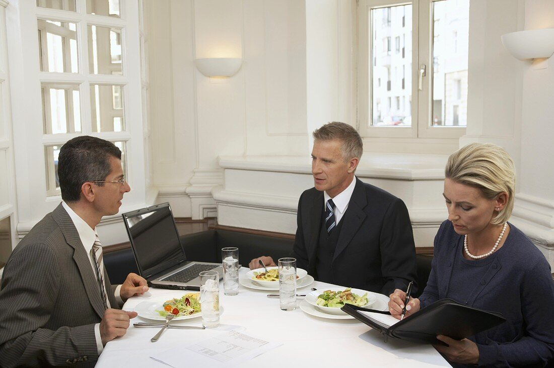Business people holding a meeting in a restaurant