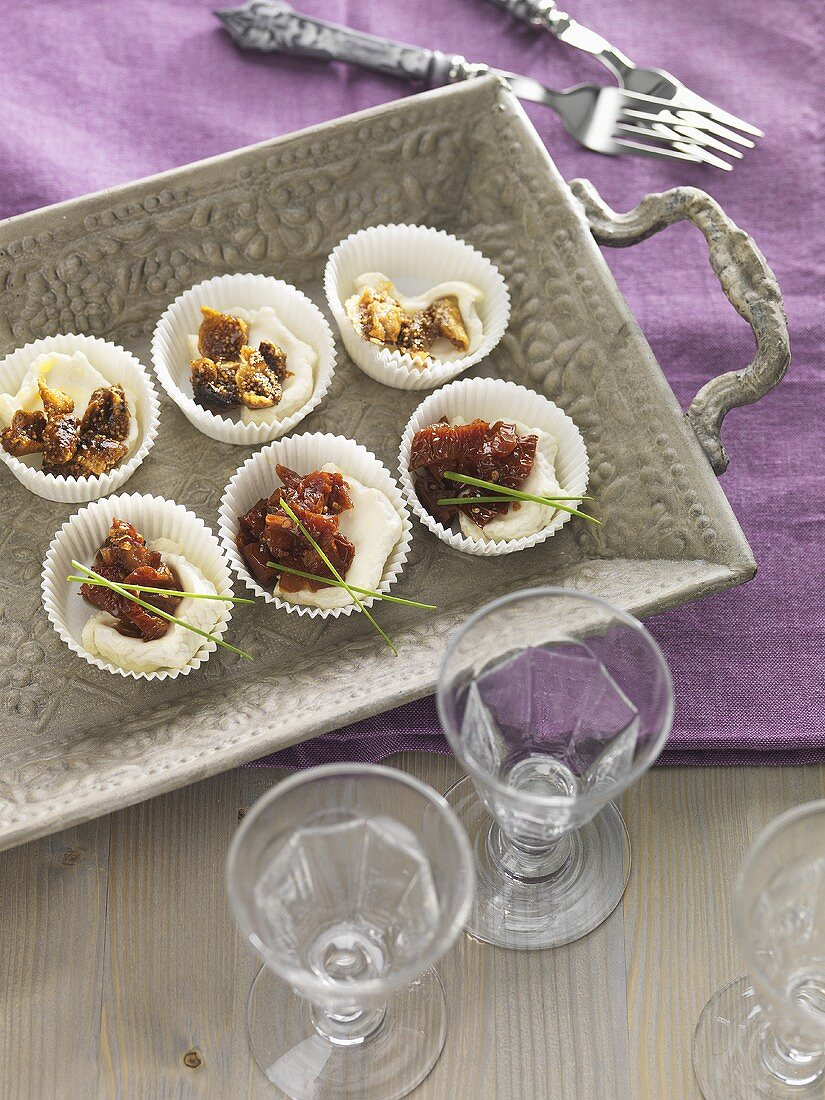 Dried tomatoes in sweet wine with goats' cheese