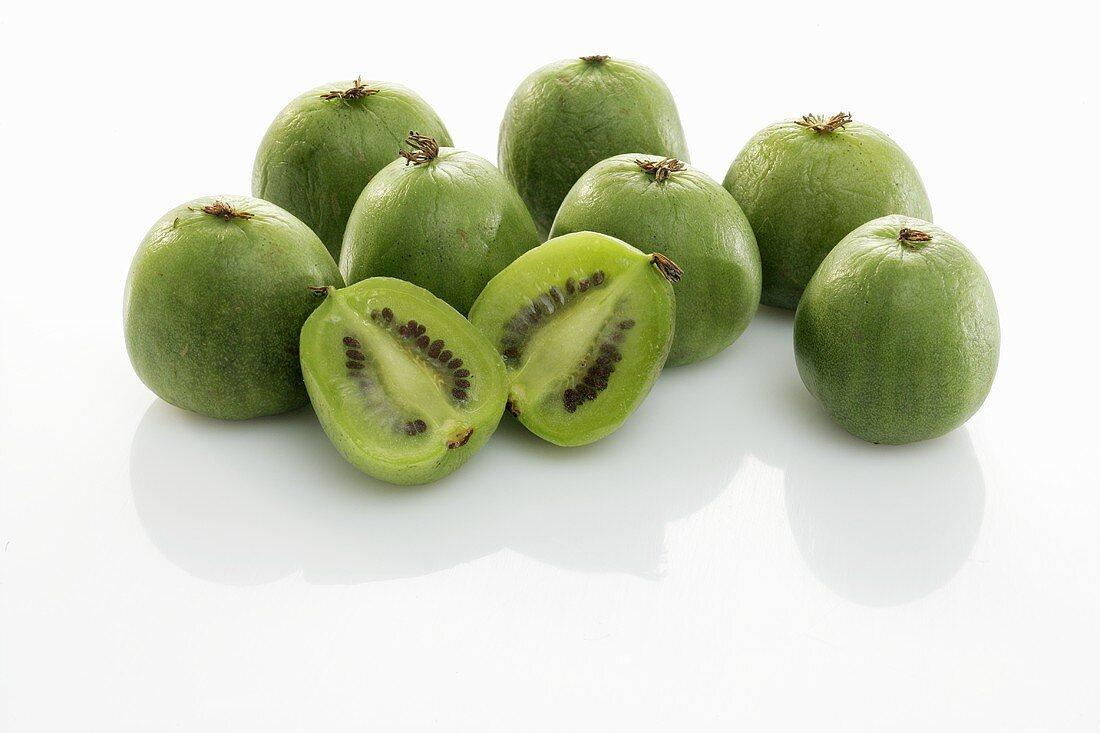 Baby kiwi fruits, whole and halved