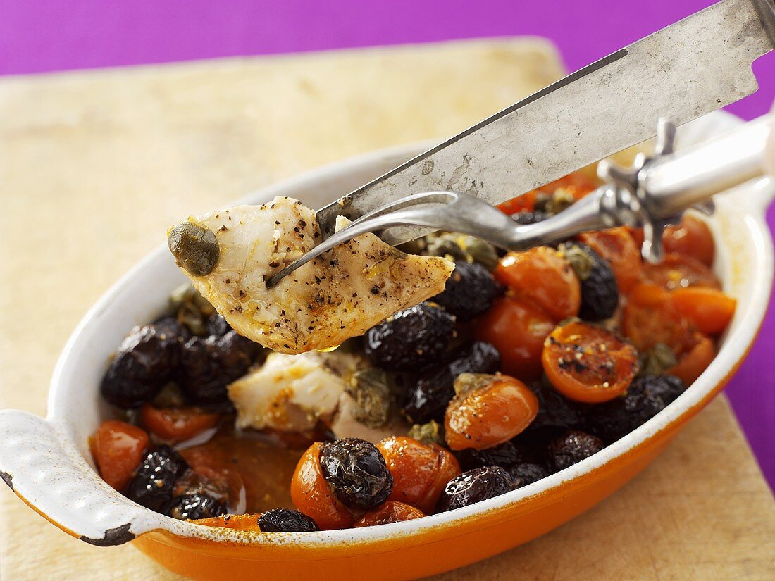 Baked chicken breast with tomatoes and olives