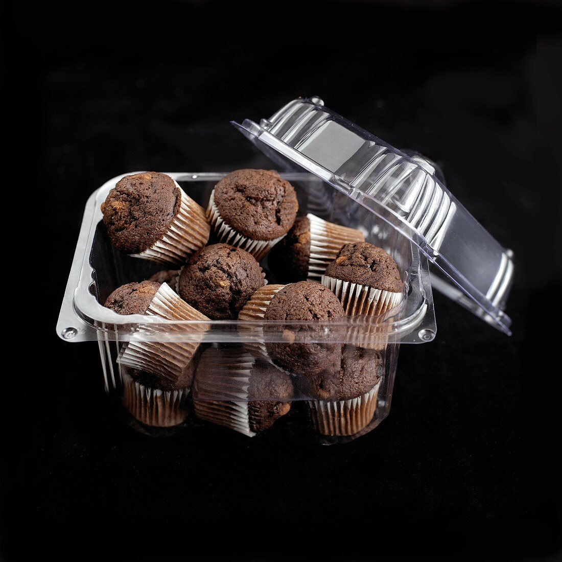 Mini chocolate muffins in a plastic container