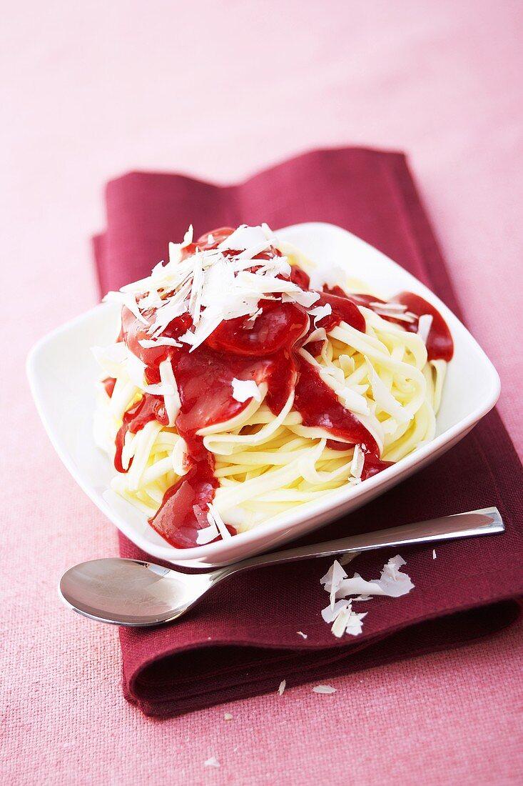 Ice cream tagliatelle with strawberry sauce & chocolate curls