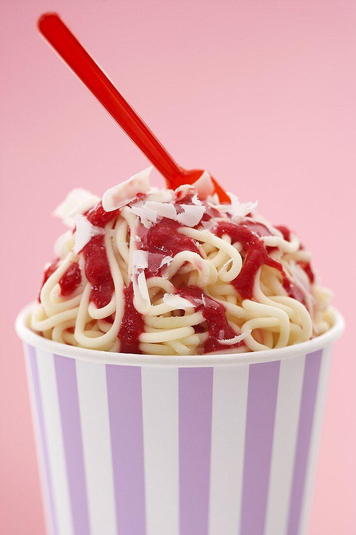 Ice cream spaghetti in cardboard tub with plastic spoon