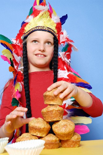 Boy dressed as Red Indian with muffins