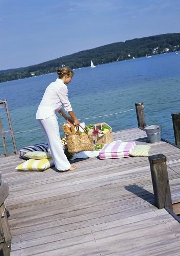 Woman with picnic basket at lakeside