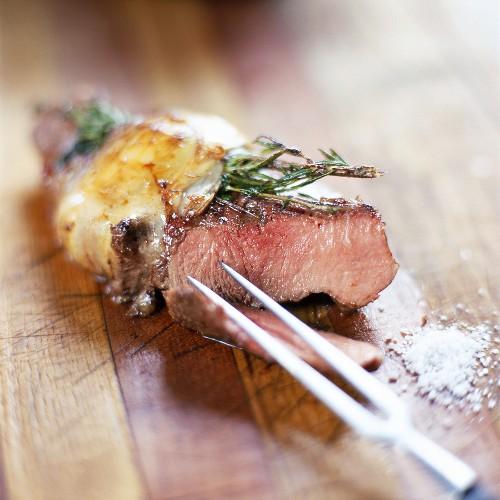 Wild boar chop in pork caul with rosemary