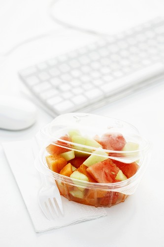 Melon salad in plastic container