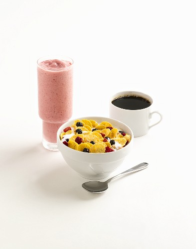 A Bowl of Cereal with Coffee and a Berry Smoothie