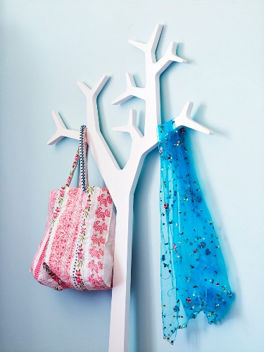 A scarf and a fabric bag hanging ip