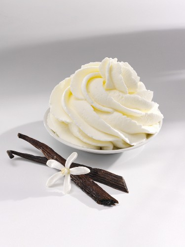 Vanilla cream, vanilla pods and a vanilla flower
