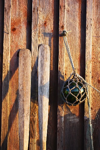 Fishing gear on a wooden wall