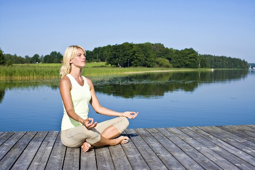 Blonde woman meditating in the Lotus position