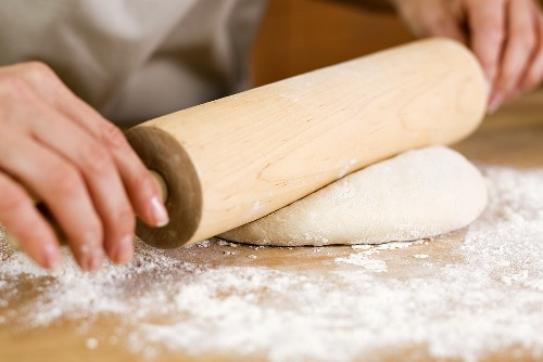 Woman Rolling Out Dough with a Rolling Pin