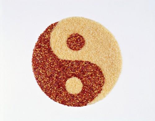 Yin yang with rice and chili, symbolising 'metal'