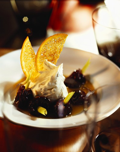 Whipped cream with pumpkin seed praline and prunes