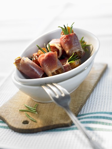Dates wrapped in bacon and rosemary
