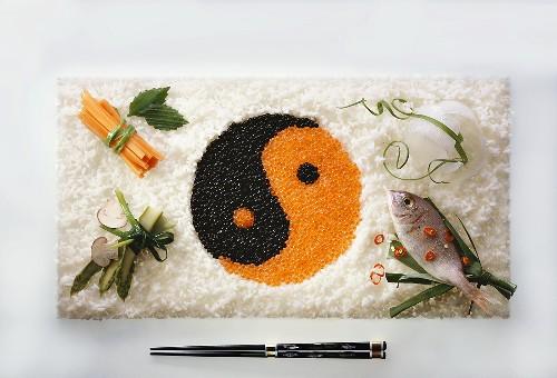 Yin-yang symbol made from caviare in rice
