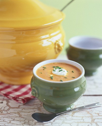 Carrot soup with sour cream and chives