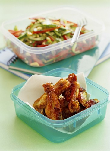 Spicy chicken thighs with salad in sandwich boxes
