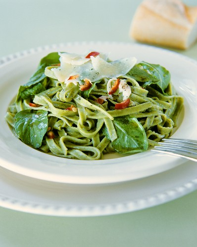 Green ribbon pasta with spinach and chili
