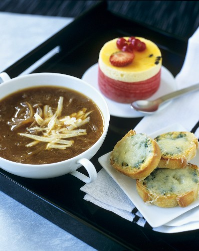 Onion soup with bread and cheese and passion fruit mousse