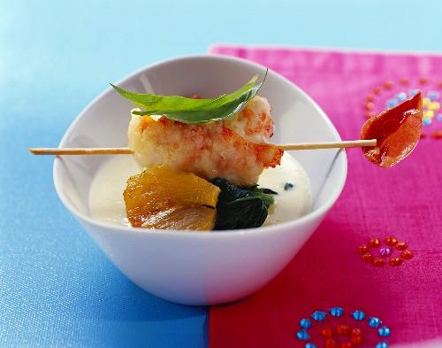 Langouste in almond tempura over polenta soup