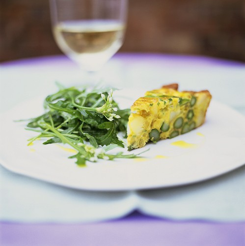 A piece of asparagus frittata with rocket salad