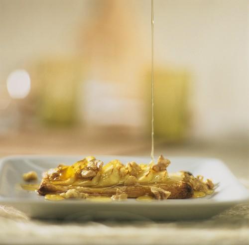 Swedish apple cake (Äppelflarn) with walnut and honey