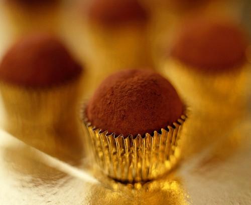 Chocolate truffles in petit four cases