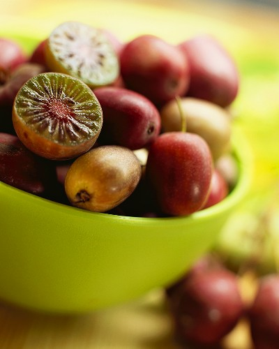 Mini-kiwi fruits in a bowl (Garden actinidia)