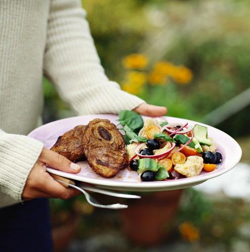 Slice of veal shank on bread salad