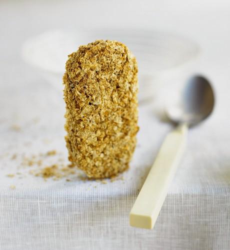 Wheat biscuit (Weetabix), a teaspoon beside it