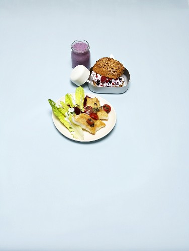 Catfish with vegetables and berry quark in bread roll