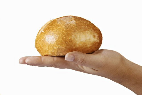 Bread roll on someone's hand