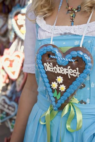 Girl with Lebkuchen heart at Oktoberfest in Munich, Germany