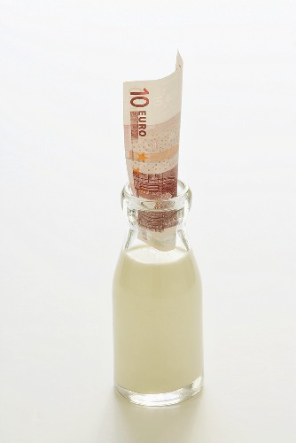 Bottle of milk with 10 euro note