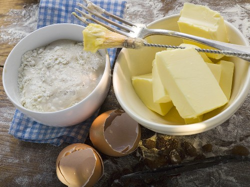 Baking ingredients (butter, yeast), pastry brush, fork