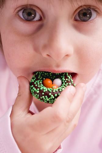 Child eating Easter sweet