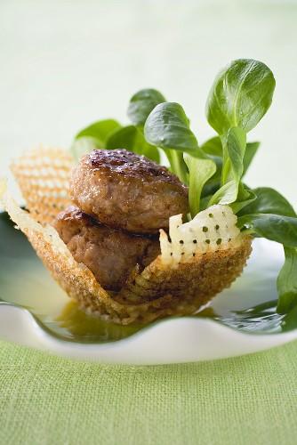 Meat patties with corn salad in potato nest