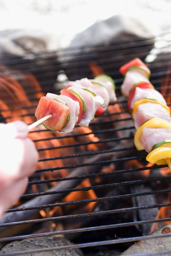 Poultry kebabs on barbecue grill rack