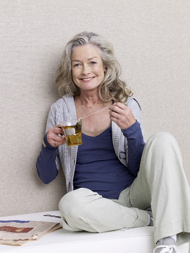 Mature woman with a glass of tea