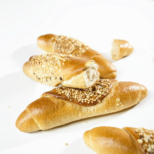 Several grain baguettes, whole and broken