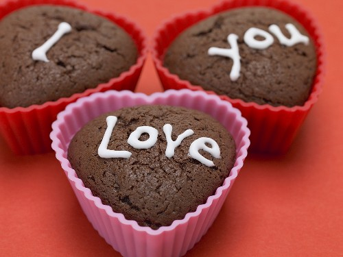 Heart-shaped chocolate muffins with sugar writing