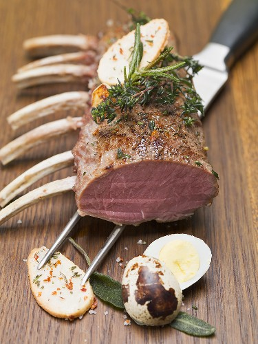 Rack of lamb with herbs, fried potatoes and quail's egg