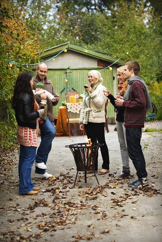 Family drinking wine in an autumn garden