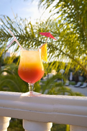 Cocktail on a balcony rail